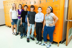 High school students by lockers represents inclusivity training for trans students in schools